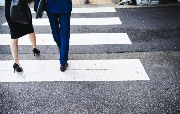 2 business professionals crossing street