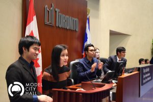 Student debating at podium