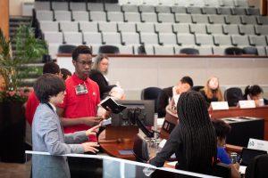 3 student at podium
